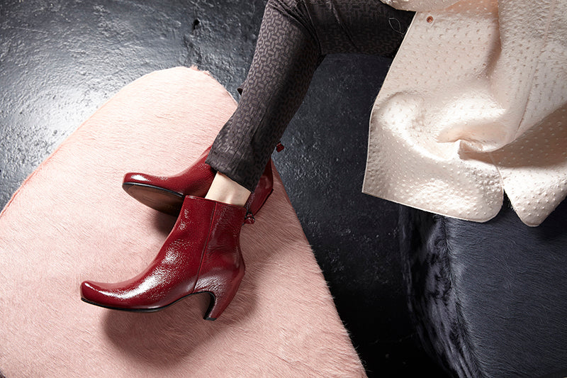 Tracey Neuls red heeled patent shoes on black floor in Elementary store Shoreditch Redchurch Street