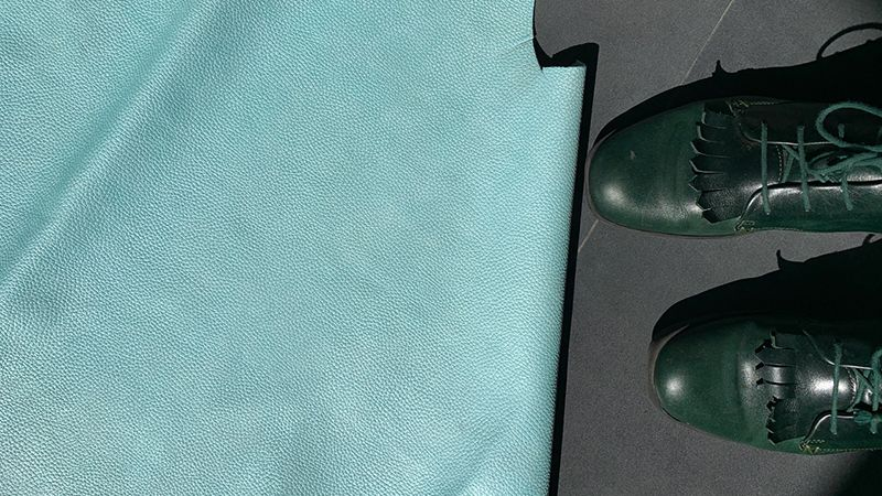 Dark green natural dye leather roper boots by London designer Tracey Neuls