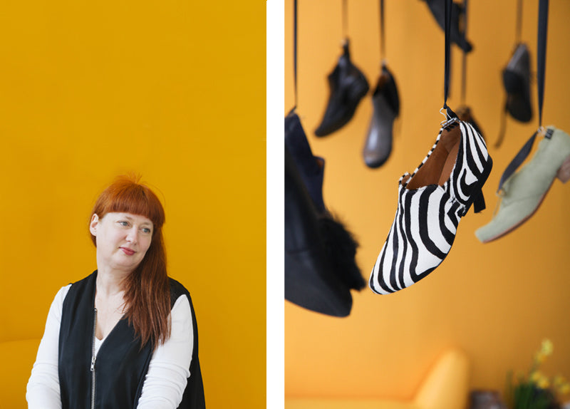 Tracey Neuls portrait yellow walls with hanging zebra print shoes