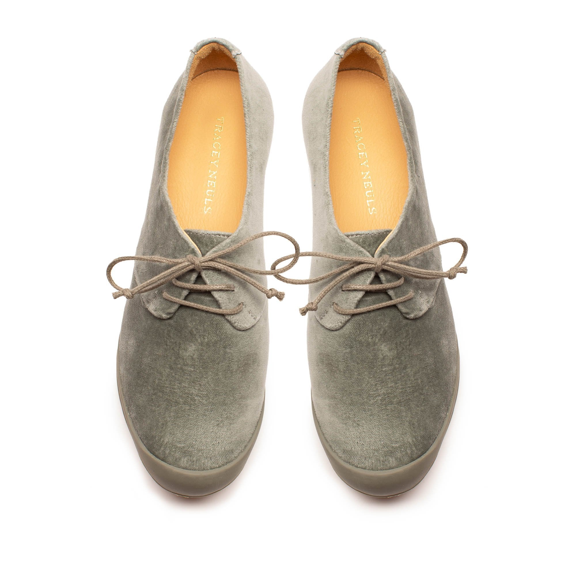 A pair of grey velvet brogues for women by London designer Tracey Neuls