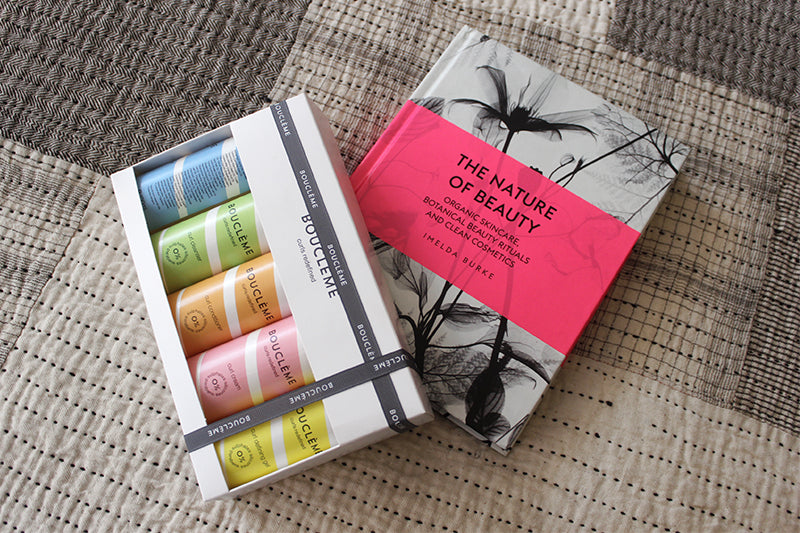 Beauty products for health and better living by Boucleme from Content Marylebone shop. A book and cosmentics box Luxuriously gift wrapped on matthew Hilton Tracey neuls bed, Marylebone Lane Shopping