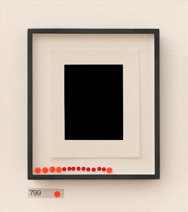 Artist print of black rectangle on white mount in black frame with red stickers