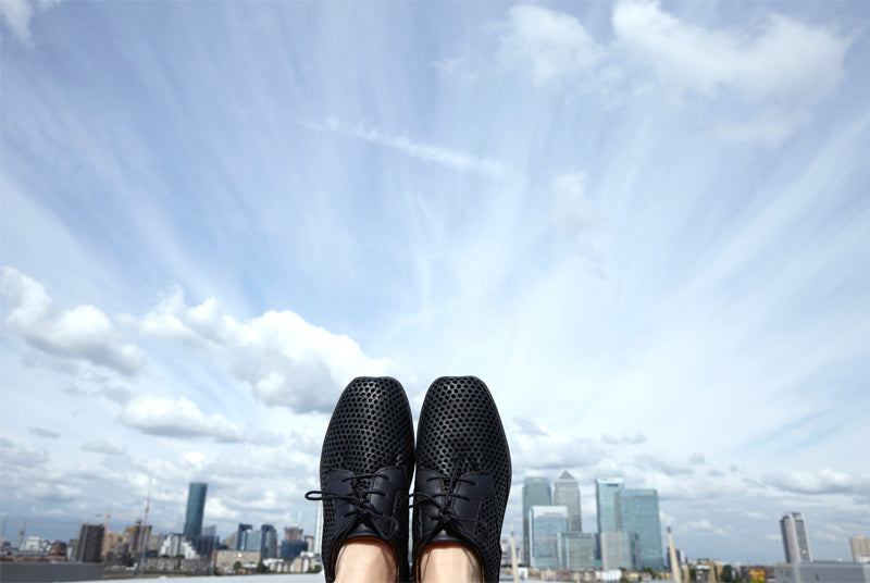 blue Sky scape with shoes in the air