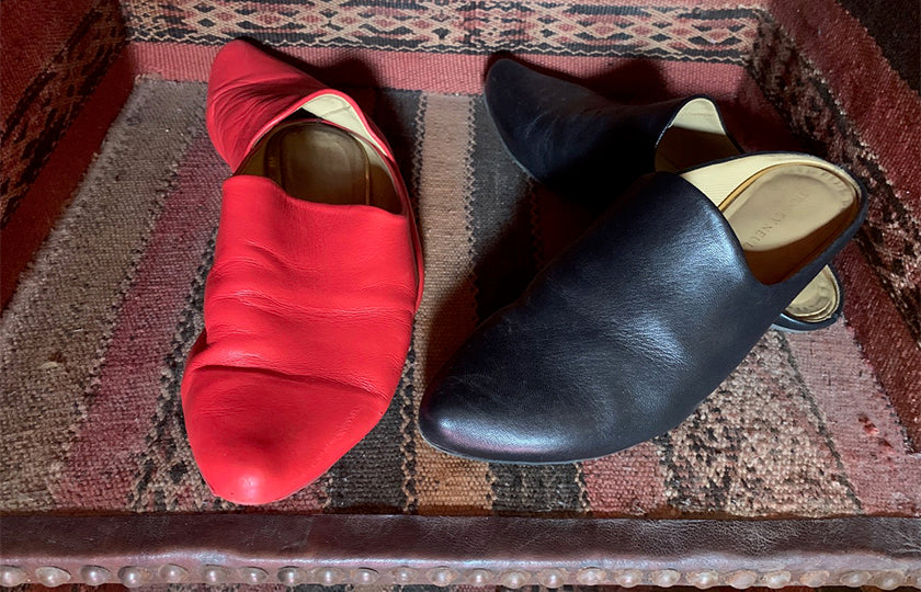 red and black leather mules by designer tracey neuls in morococo