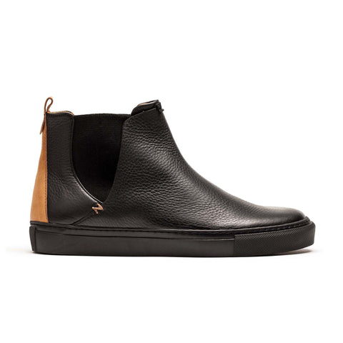 Rubber sole Chelsea boot in black leather for men by designer Tracey Neuls