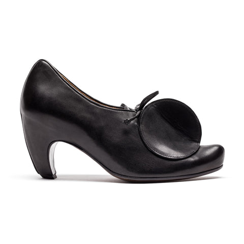 Black High Heel shoe with a circle design by Tracey Neuls