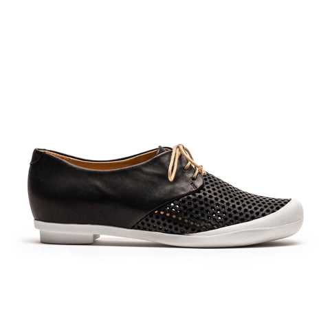 black perforated sneaker designed by Tracey Neuls