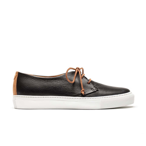 a black mens leather sneaker made by hand from artisans in Portugal. Designed by Tracey Neuls