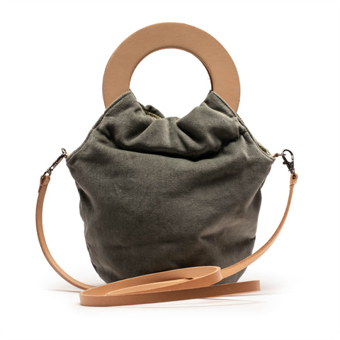 green leather reversible handbag designed by Tracey Neuls