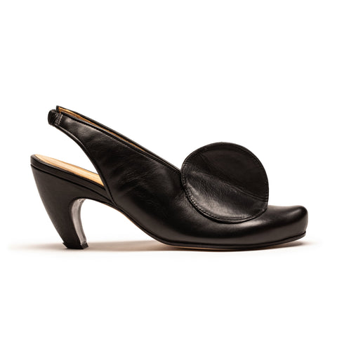 Designer Tracey Neuls most iconic shoes featuring sculptural detailing, mid-heel in black leather
