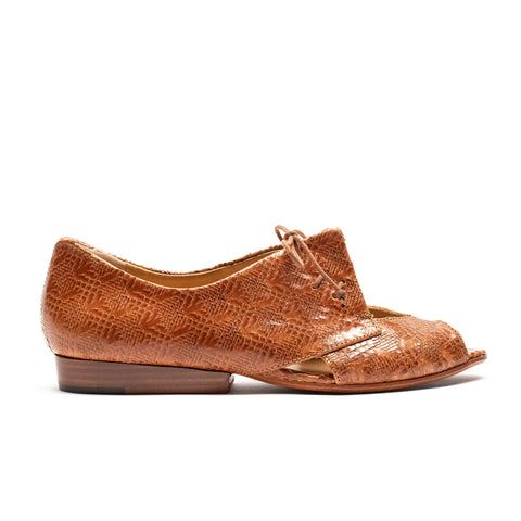Flat leather shoe with faux snake skin print and interesting detailing by tracey neuls