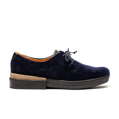 a modern twist on the women's derby shoe in a luxurious blue velvet by designer Tracey Neuls
