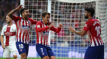 Atlético send Madrid derby message with Huesca win