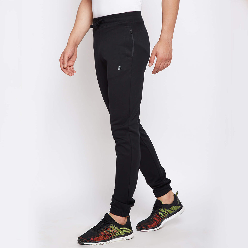 black premium joggers with super stretch, hydrophobic finish makes it water-based stain repellent and odour free, from Turms. With zipper pockets.