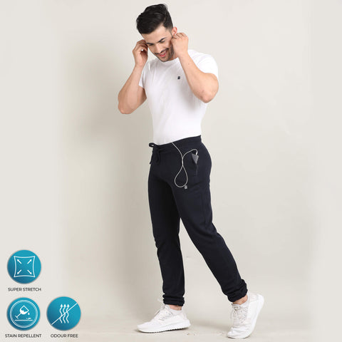 dark blue premium joggers with super stretch, hydrophobic finish makes it water-based stain repellent and odour free, from Turms. With zipper pockets.