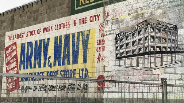 Army & Navy mural uncovered during building demolition