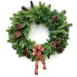 A classic holiday wreath with pinecones and a bow.