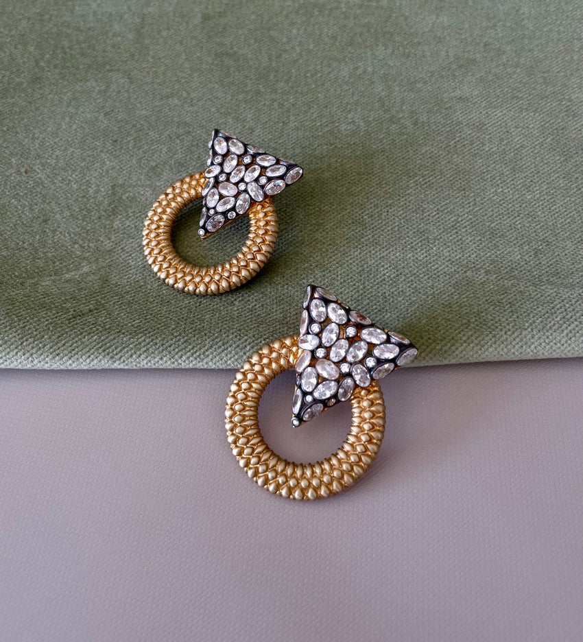 statement gold earrings designed by MAHISA NIKVAND