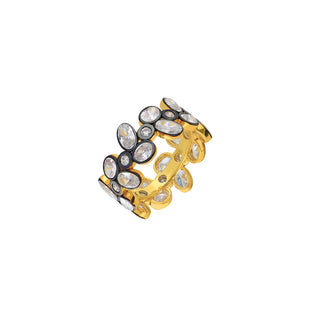 Gold ring embellished with gemstone.