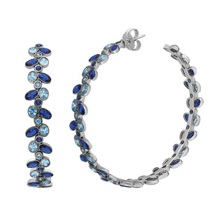 Statement hoop earrings adorned with blue gemstone.
