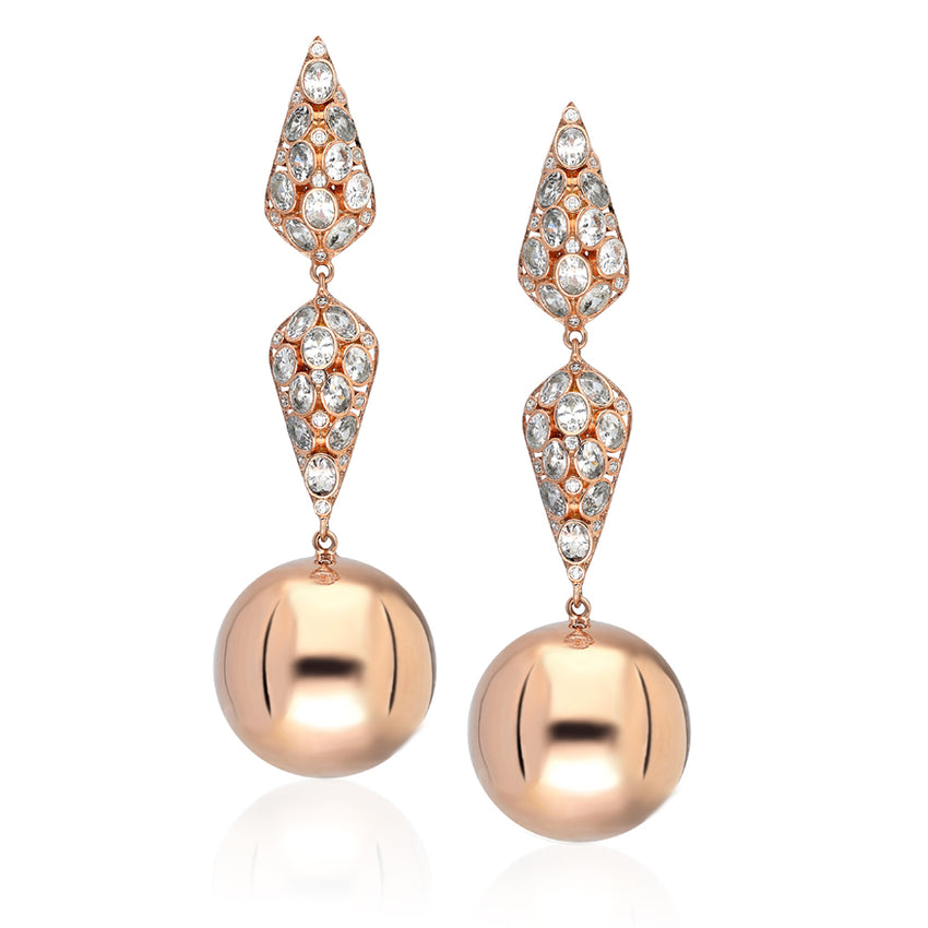 Ennata sterling silver earnings with a hanging round ball in rose gold plated.