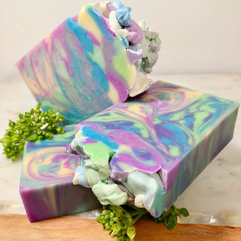 Eden's Garden Buttermilk Soap. Artisan handmade soap bars. Swirls of blue, green, purple, and yellow.