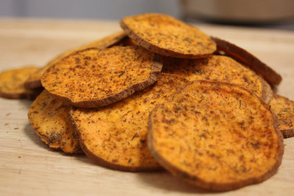 Baked in organic virgin coconut oil with sea salt, organic dill weed, organic chipotle powder and organic garlic granules then freeze dried for a unique texture these organic sweetpotato slices are very similar to a cracker. Vegan and naturally gluten free these snacks are ideal as a long term survival, hiking or camping food.