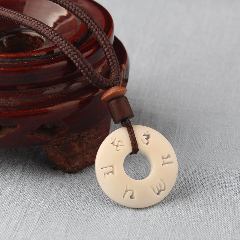 Hand-Carved Mantra Sign Tagua Nut Pendant/ Six WordsTibetan Buddhist Amulet