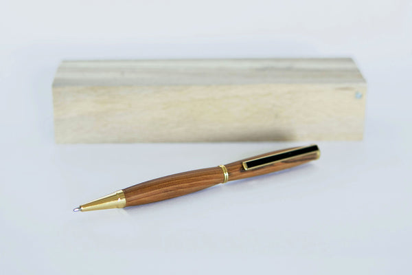 Hand turned pen of dark native irish wood with wooden pen box.