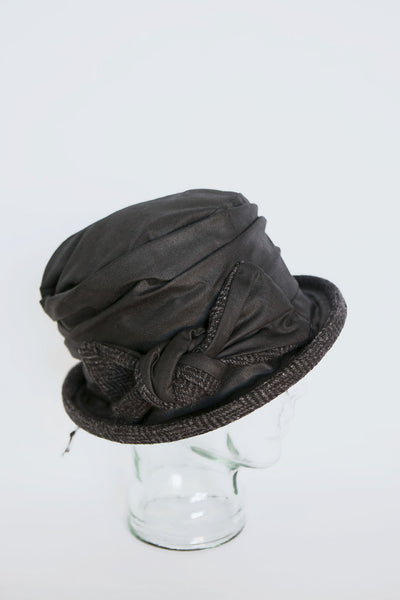 Traditional Irish tweed and wax cotton hat on glass display