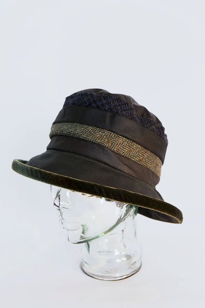 Model head wearing a handmade classic wax and Irish Tweed Rainhat