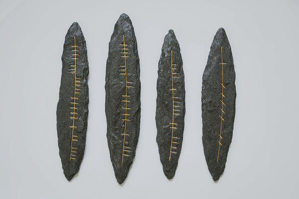 Four traditional dark grey slate wall hangings with Irish Ogham script in gold