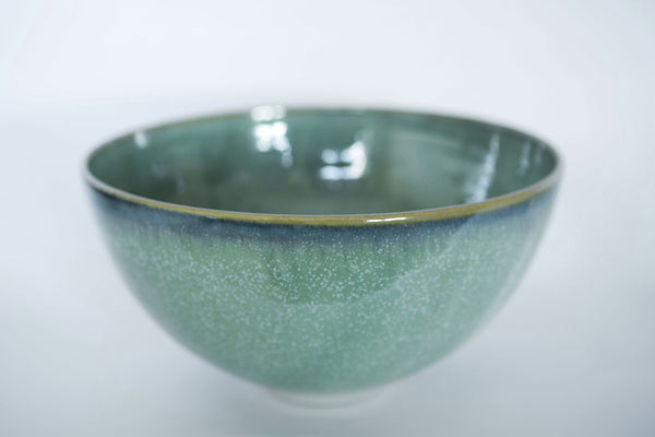 Green and white speckled salad bowl with a blue line around the rim makes a lovely irish craft gift