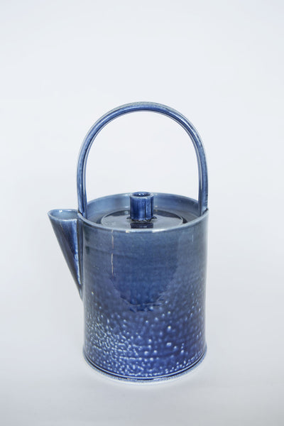 Irish crafted teapot in blue done in a contemporary round style with white speckles on the lower half