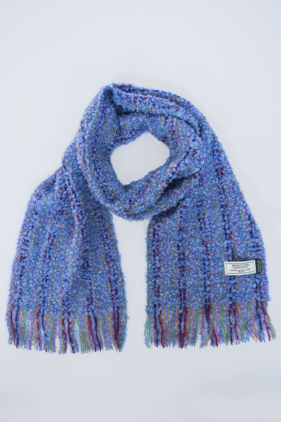 Irish crafted woven scarf in blue with threads of navy, red and green through the weaving