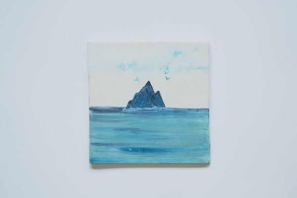 Wallhanging of Skellig Rock in Ireland. Handmade and painted in stoneware clay with a blue and turquoise glaze