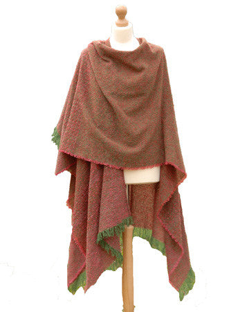 Shop this Irish Kelly Rose Celtic Ruana with shades of pink and brown with green edging on a tailor's Mannequin