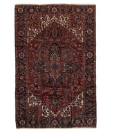 Antique Persian Heriz is a 8x12 hand knotted rug