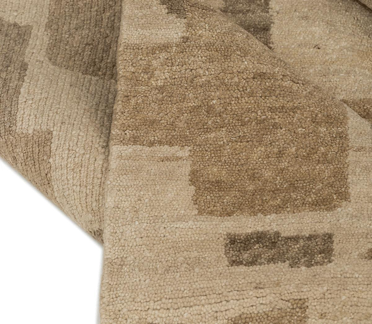 Detail shot of BAKUBA BEIGE, a hand knotted rug designed by Tufenkian Artisan Carpets.