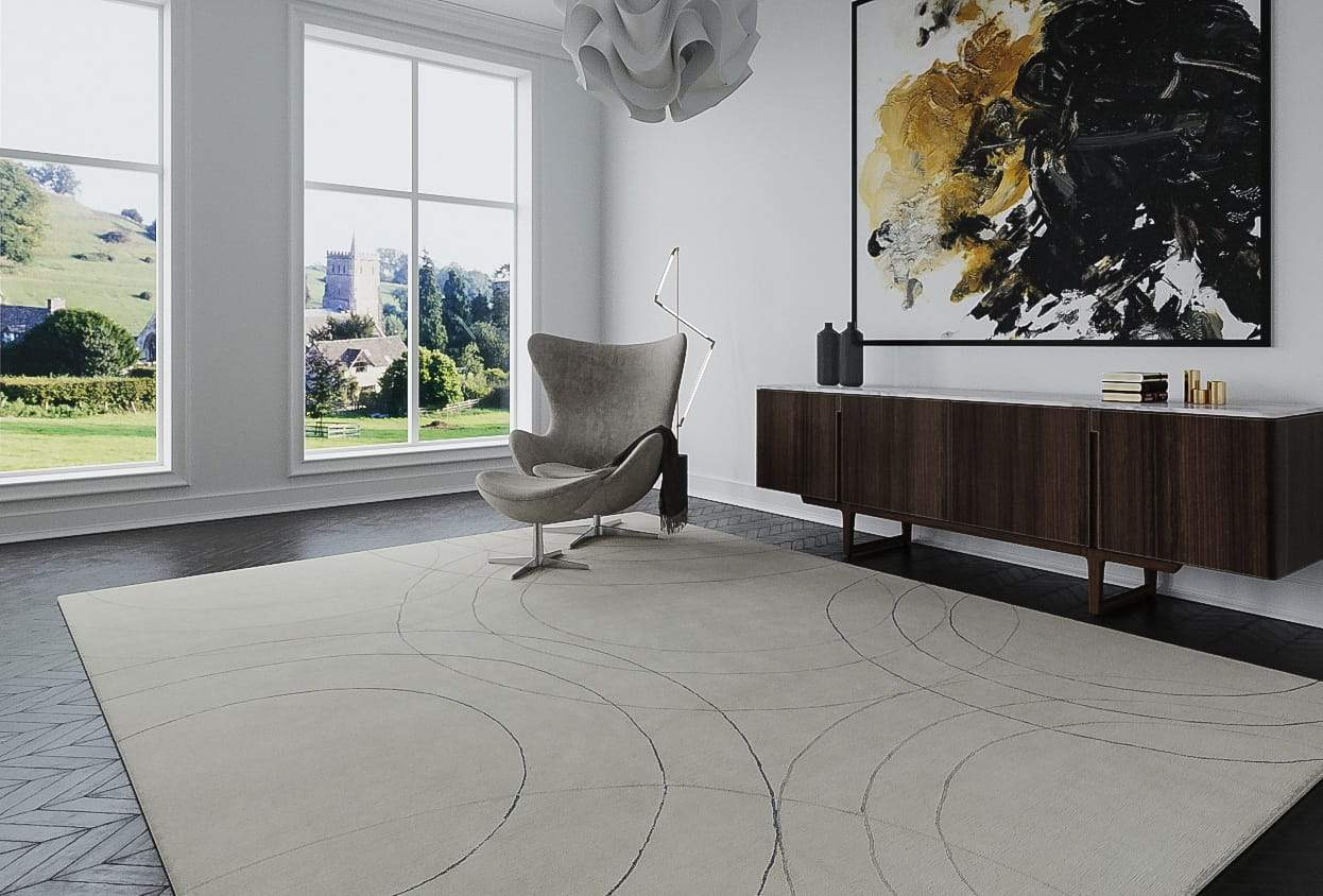 Installation shot of Cirque Pewter, a hand knotted rug designed by Tufenkian Artisan Carpets. room-image