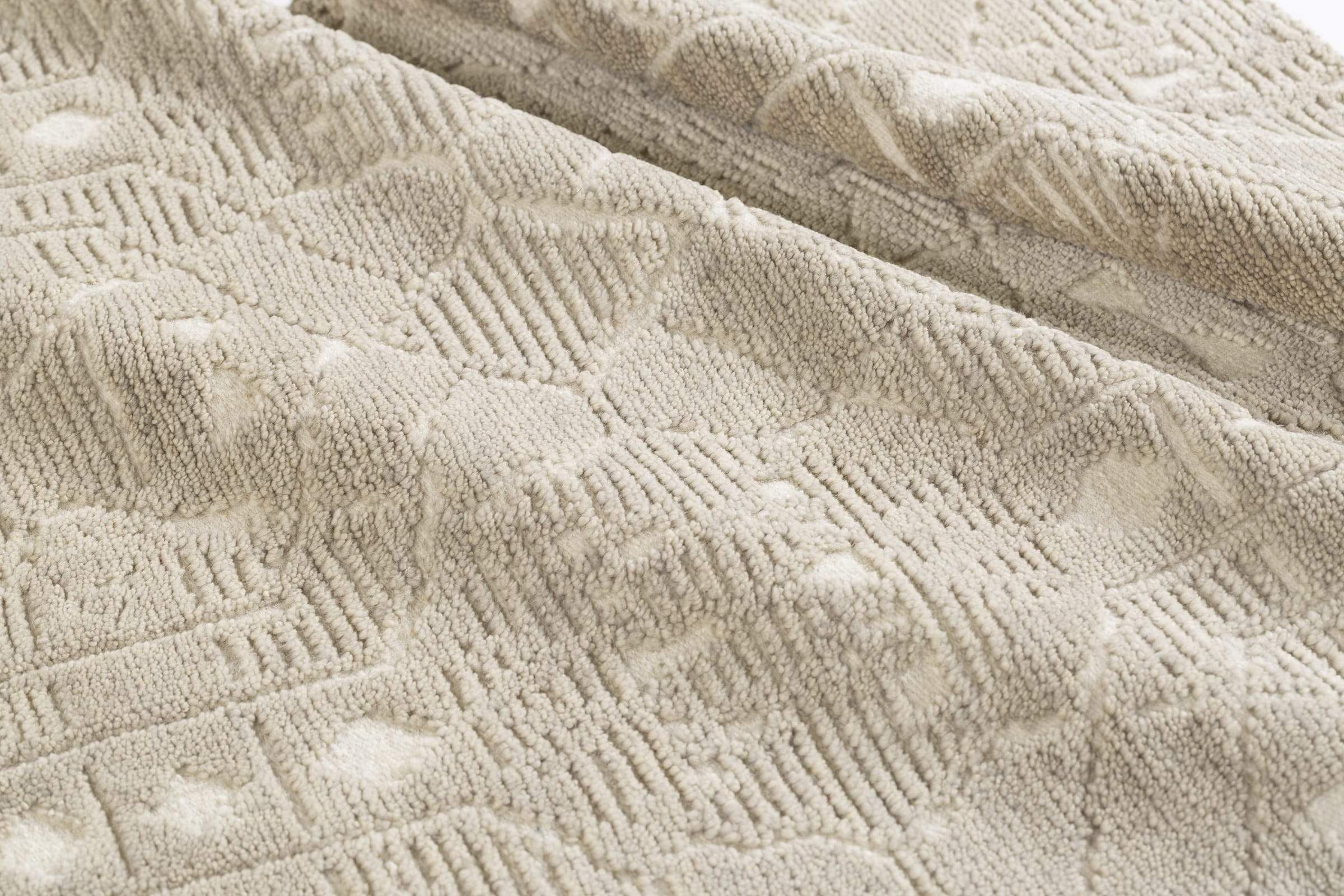 Detail shot of Monreale Light Taupe, a hand knotted rug designed by Tufenkian Artisan Carpets.