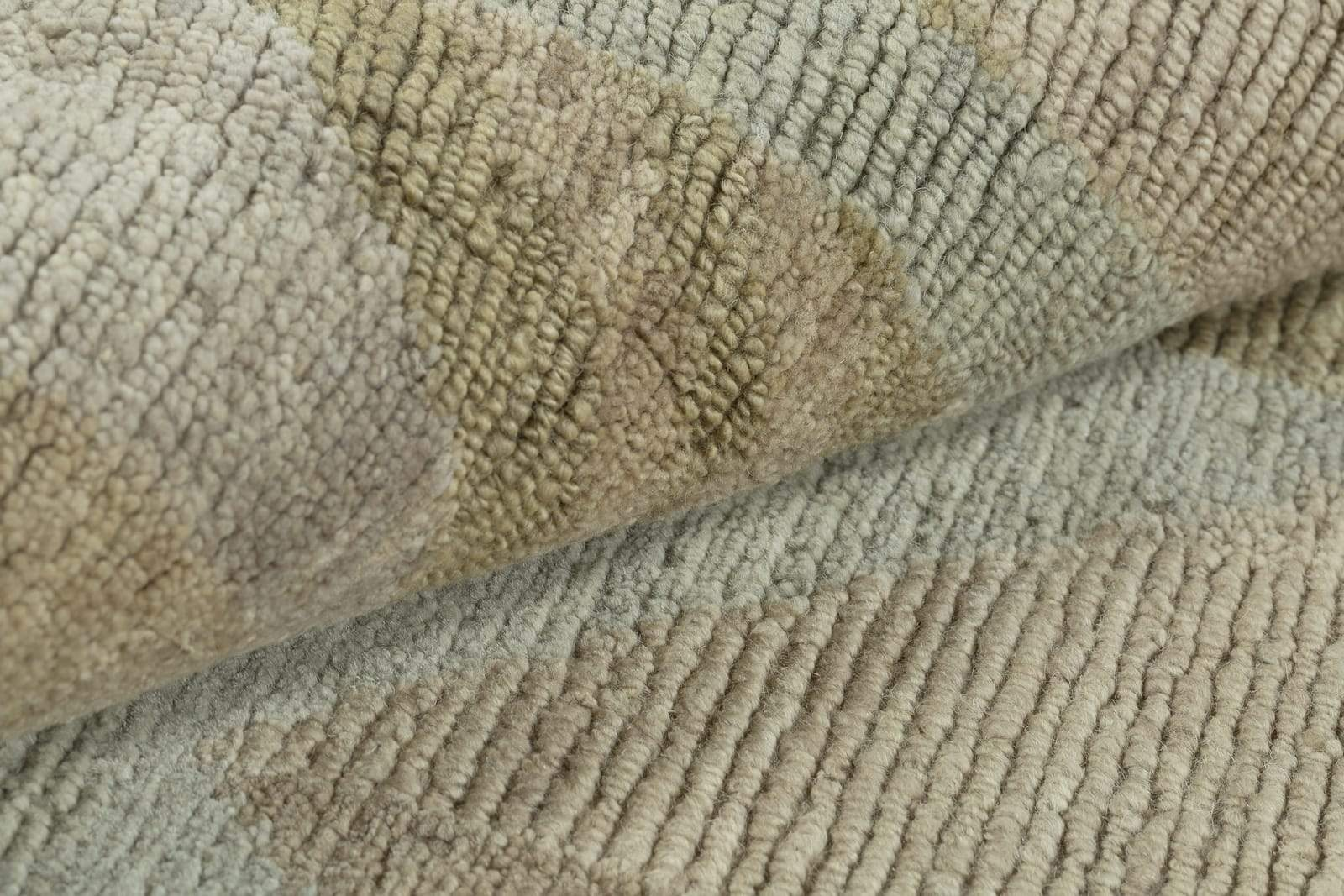 Detail shot of Malmo Soft Lichen, a hand knotted rug by Tufenkian Artisan Carpets