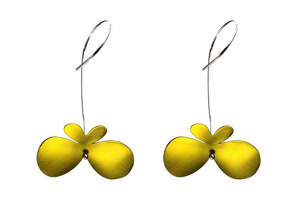 Butterfly earrings made of yellow titanium with long silver hooks.