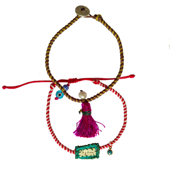 Set of charm bracelets made of silk strings with colorful ornaments in  Fuchsia & Turquoise shades.