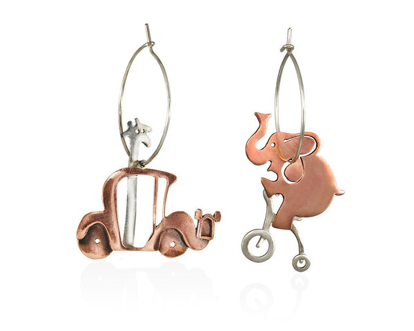 A giraffe so tall that her head is coming out of the roof of her car, randomly meets her best friend, the elephant, like a perfect acrobat riding his bike. Hoop sterling silver and copper earrings