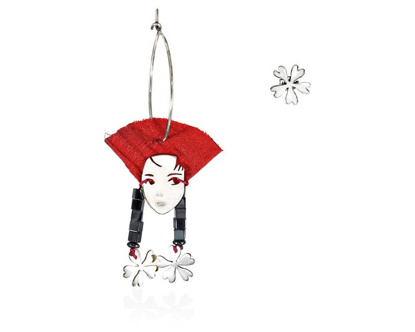 A portrait of a beautifl lady of the far east with her red silk hat and her long hematite  and flower earrings.  Hoop and stud earrings made of sterling silver  gems and silk