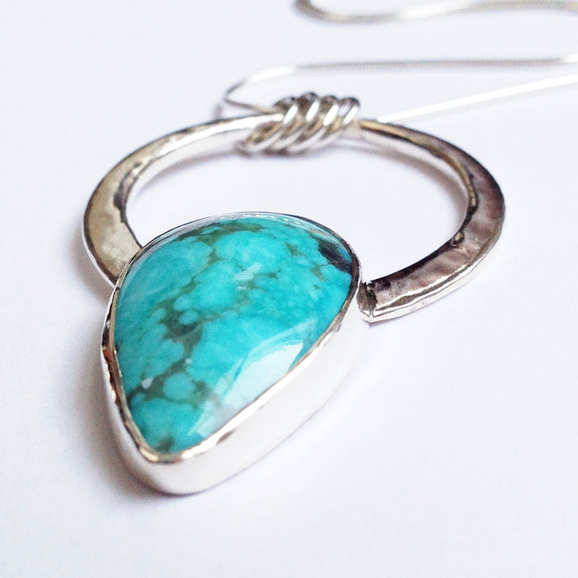 Modern Bohemian Silver and Turquoise Encircled Pendant