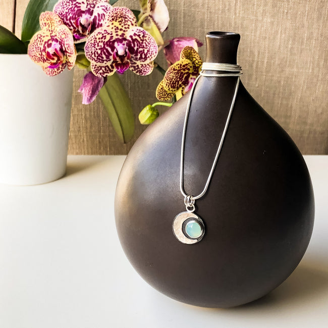 Aqua_Chalcedony_Crescent_Moon_Pendant_On_Vase