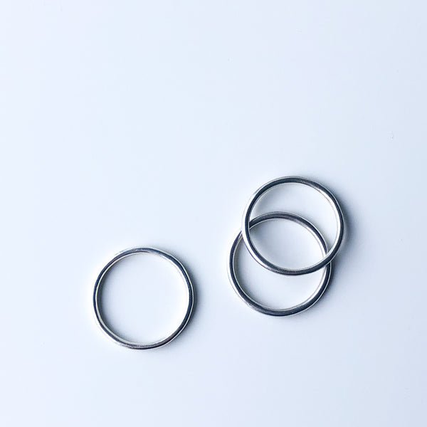 Three plain silver stacking rings