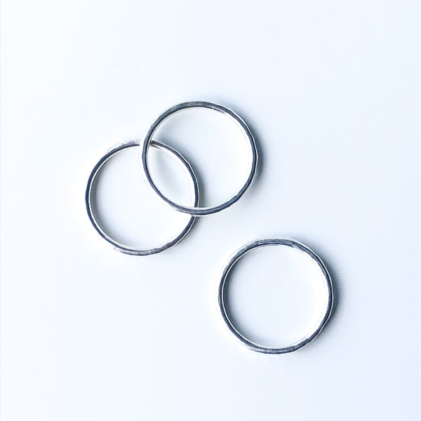 Top view of three hammered texture stacking rings